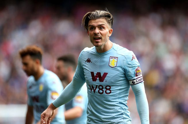 Jack Grealish reacts after being booked for diving
