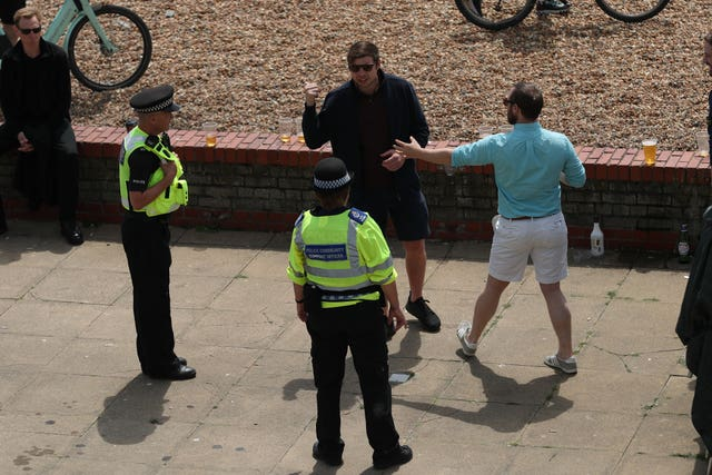 Police talk to people on the sea front