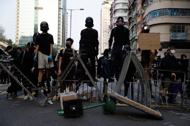 Protesters stand on a barricade