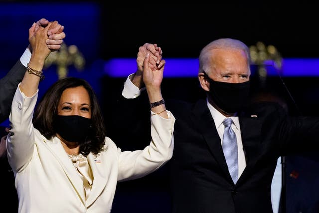 Vice President-elect Kamala Harris holds hands with President-elect Joe Biden