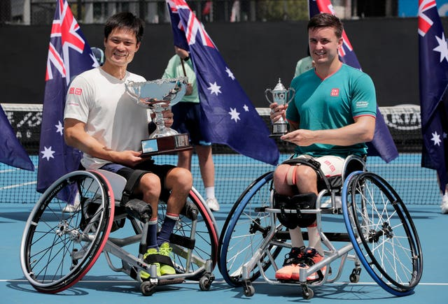Gordon Reid, right, poses with his runners-up trophy alongside champion Shingo Kunieda