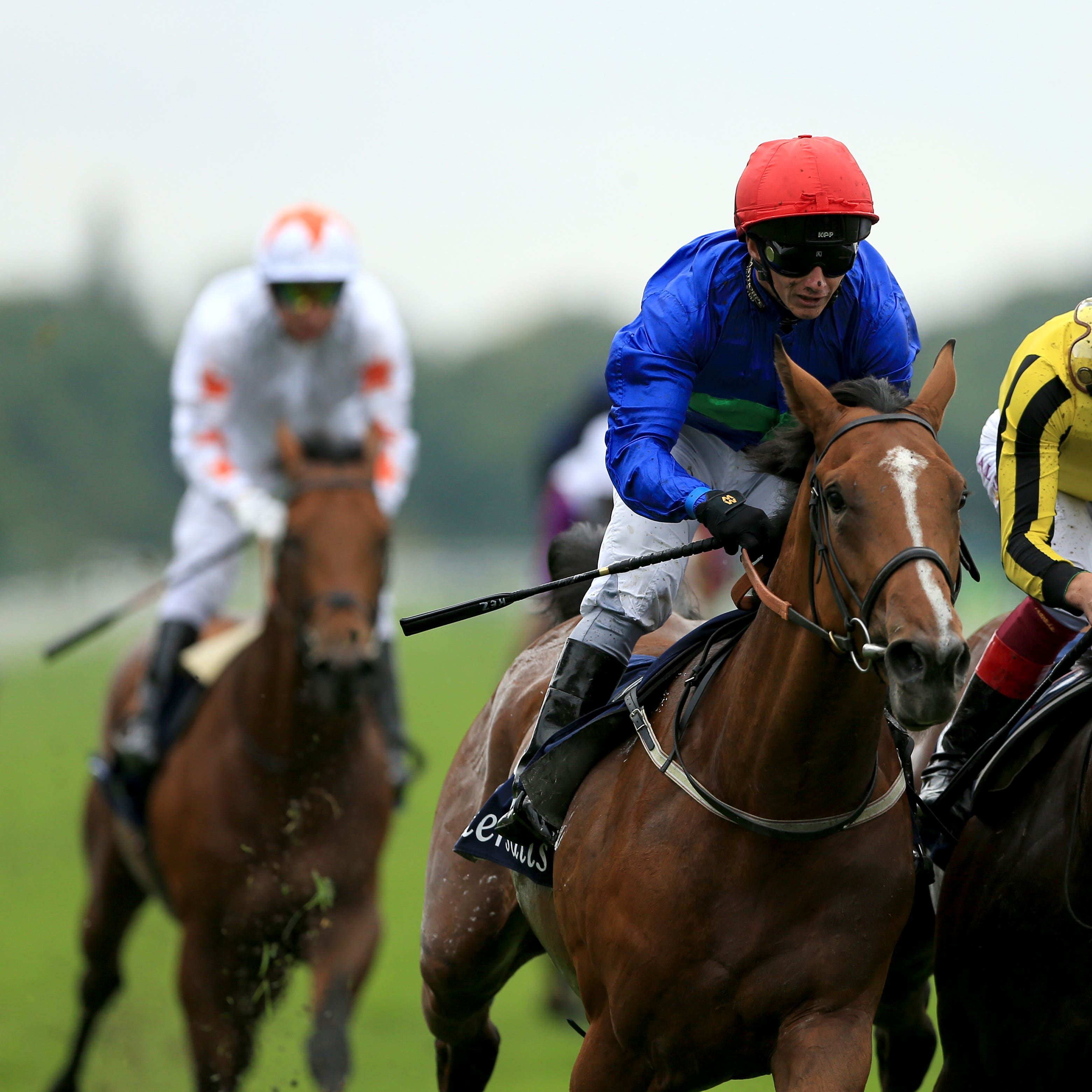 Wells Farhh Go (red hat) gets the better of James Garfield in the Acomb Stakes (Tim Goode/PA)
