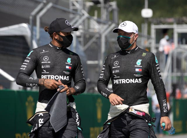 Hamilton, left, believes there is a divide on the grid regarding the