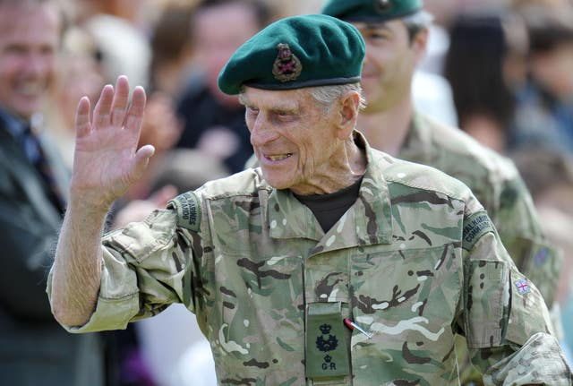 The Duke of Edinburgh waves to the crowd after presenting campaign medals to members of 40 Commando (Tim Ireland/PA)