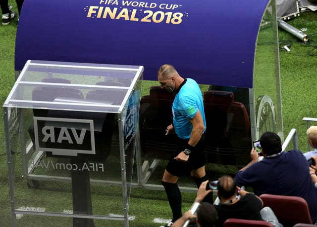 2018 World Cup final referee Nestor Pitana checks the pitchside monitor