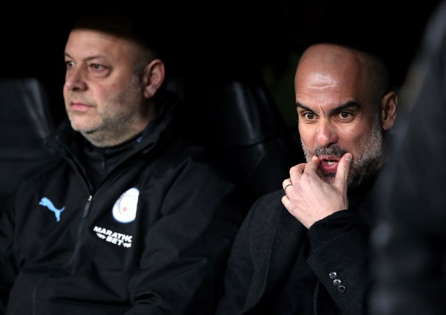 Pep Guardiola, right, shocked many with his team selection