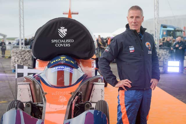 Pilot Andy Green stands beside the Bloodhound 1,000mph supersonic racing car before its first public run at Cornwall Airport, near Newquay (Ben Birchall/PA)