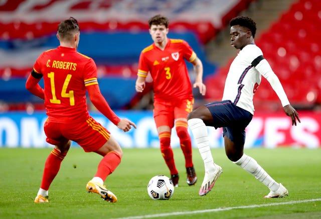 Saka, right, played 76 minutes at Wembley
