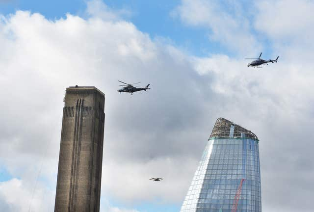 A pair of helicopters circle the chimney top of the Tate Modern gallery in London for another death-defying scene, set to appear in Mission: Impossible 6.