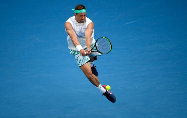 Tennys Sandgren jumps into a backhand during his victory over Fabio Fognini