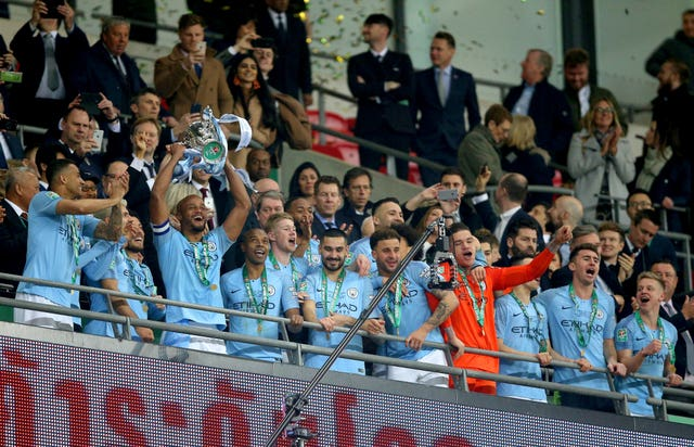 Manchester City collect the Carabao Cup trophy after beating Chelsea in the final