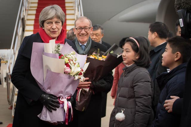Theresa May arrives at Wuhan Tianhe International Airport (Stefan Rousseau/PA)
