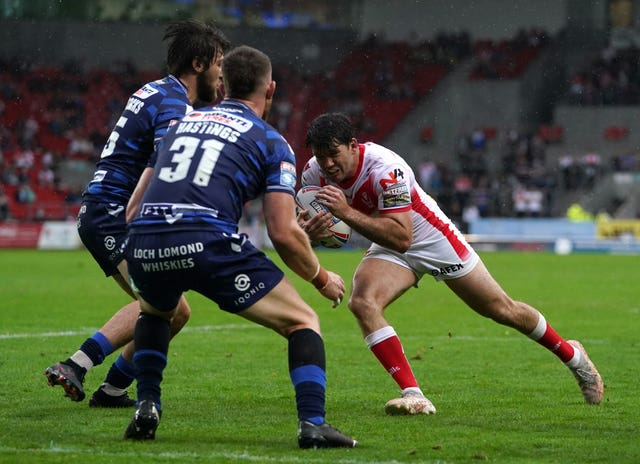 Lachlan Coote, right, scored a try and six goals as St Helens beat Wigan 24-6 on Sunday at a Totally Wicked stadium in the rain.