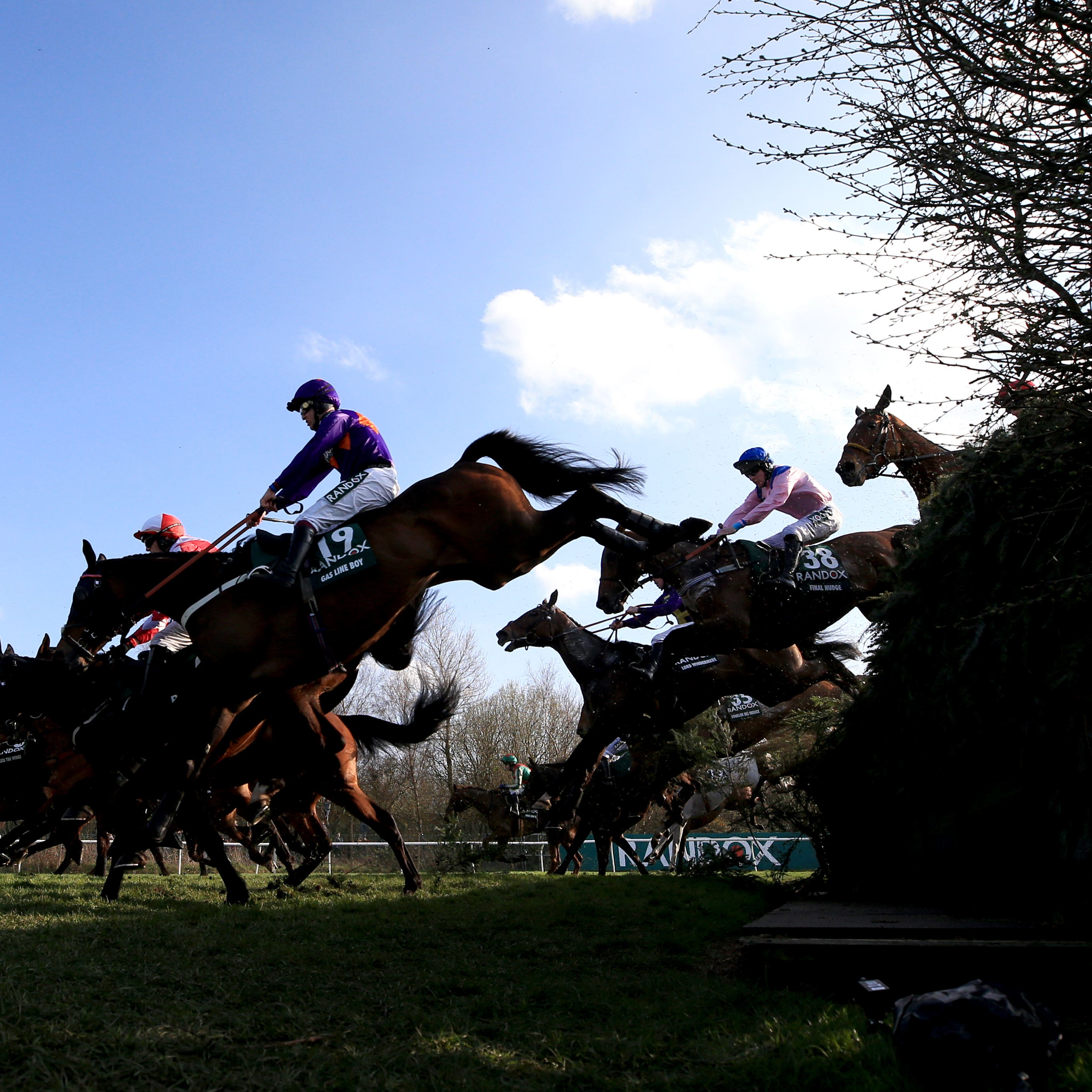 Runners and riders compete in the 2018 Grand National