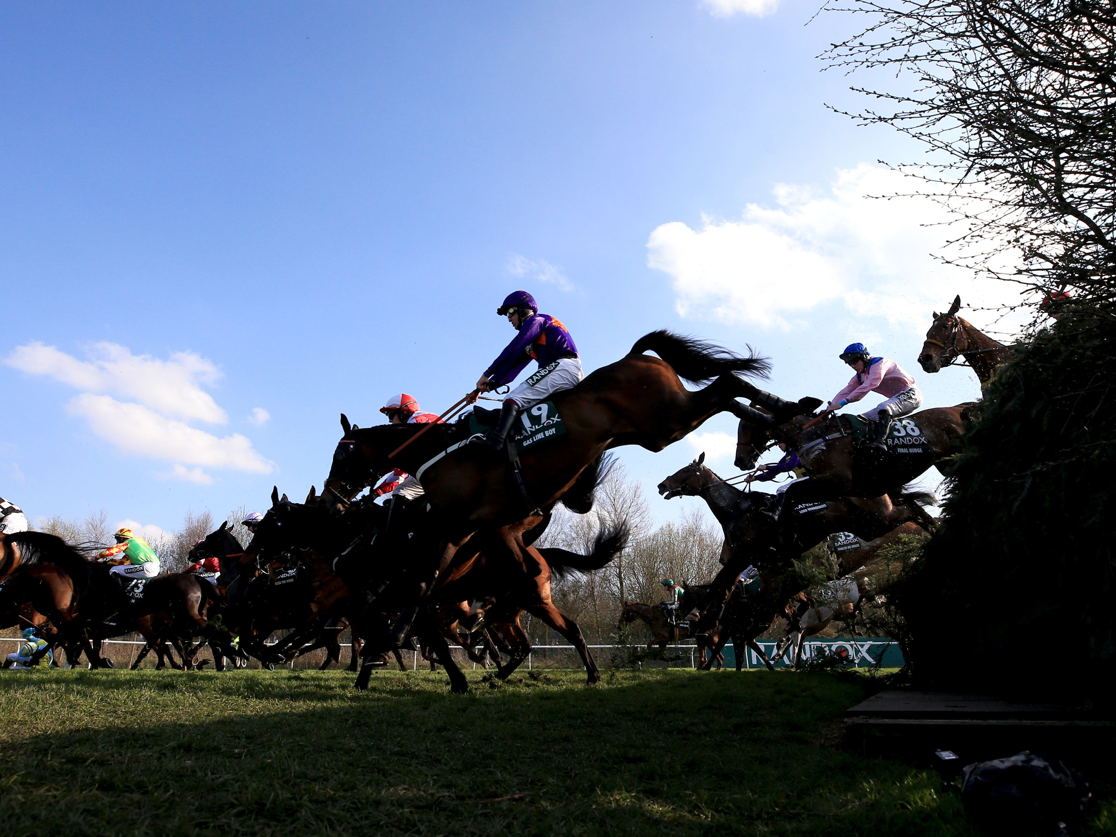 Runners and riders compete in the 2018 Grand National (Peter Byrne/PA)