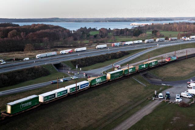 An aerial view of a cargo train with damaged compartments near the Storebaelt bridge, near Nyborg in Denmark