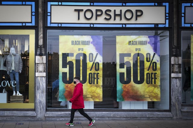 A Topshop store with sales posters