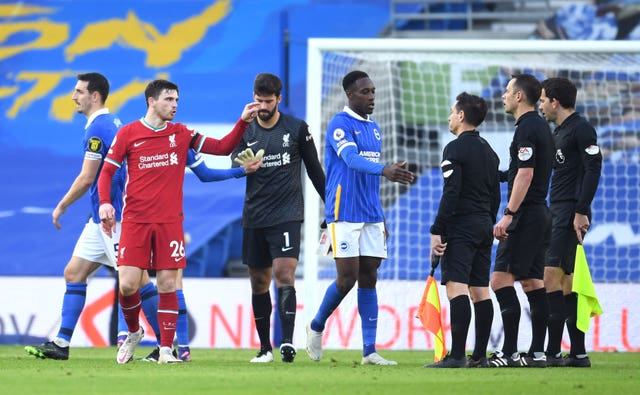 Liverpool's Andy Robertson (second left) gave away a penalty against Brighton on Saturday following a VAR intervention