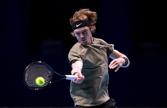 Andrey Rublev strikes a forehand during his loss to Stefanos Tsitsipas