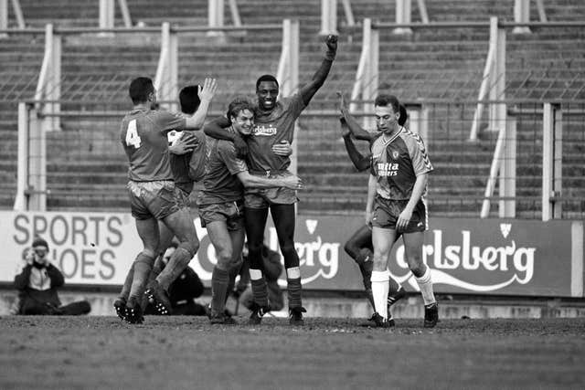 Forward John Fashanu (centre) became a key man for the 'Crazy Gang'