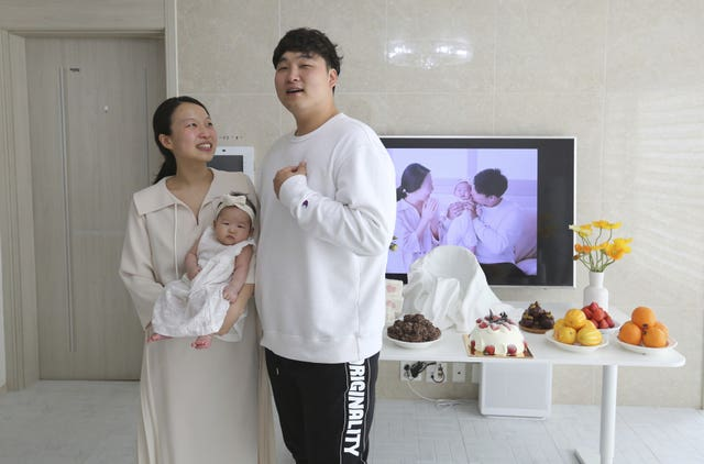 Lee Dong Kil with his wife Ryu Da Gyeong and daughter Lee Yoon Seol at their house in Daejeon, South Korea