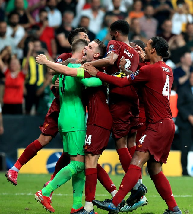 Liverpool goalkeeper Adrian celebrating shortly before he was felled by a supporter