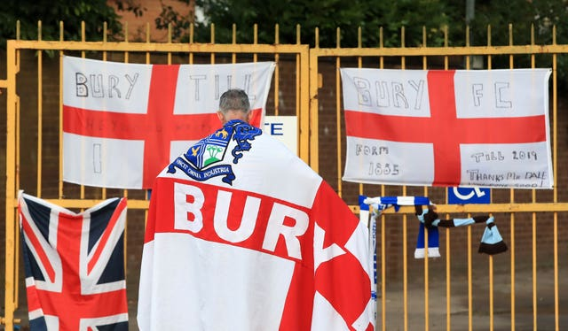 A Bury fan at the gates of Gigg Lane