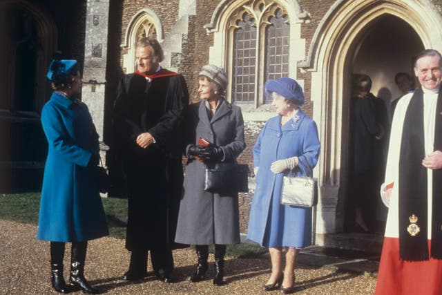 American evangelist Billy Graham (second left) speaking to the Queen, and the Queen Mother, when he preached at Sandringham Parish Church (PA)