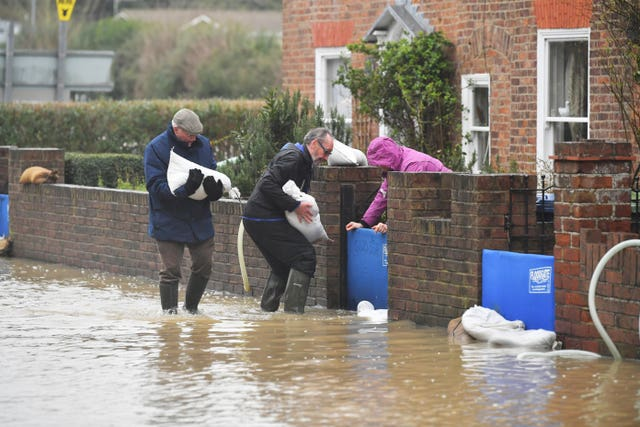 Residents position sandbags in Tewkesbury