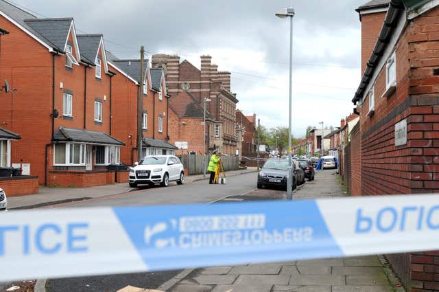 Police at the scene in Ettington Road in Aston (Matthew Cooper/PA)