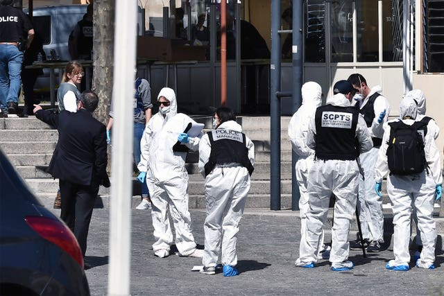 Police officers investigate after a man wielding a knife attacked residents venturing out to shop under lockdown in Romans-sur-Isere, southern France