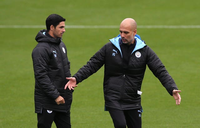 Guardiola was coy on footage appearing to show former assistant Mikel Arteta (left) encouraging tactical fouls