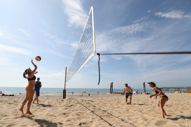 The sun was shining on Boscombe beach as players enjoyed a game of volleyball