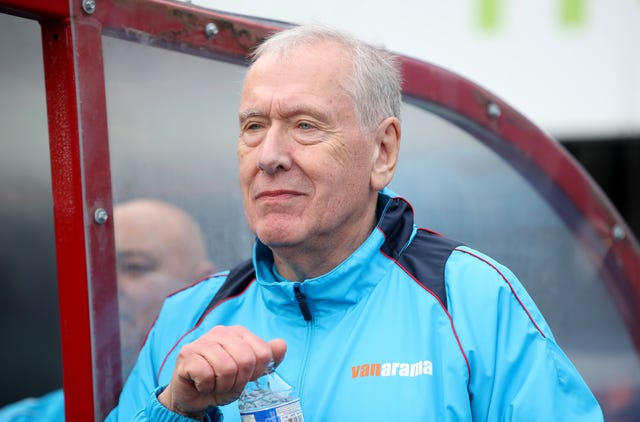Martin Tyler, pictured during Woking's defeat to Watford, is part of the non-league club's coaching staff