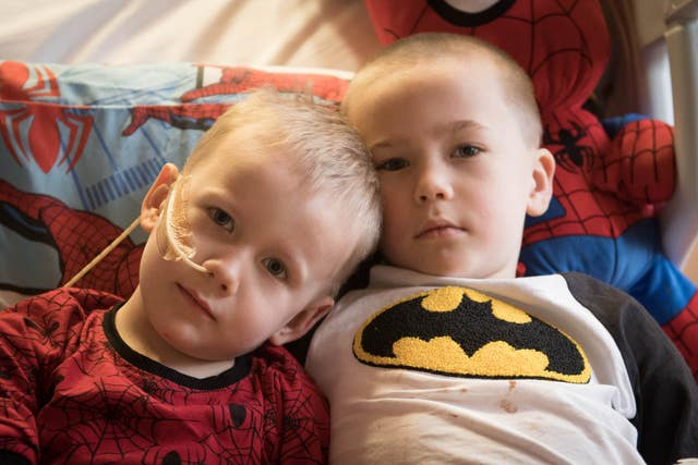 Brothers, four-year-old Ollie (left) and Finley Cripps, six, from Sittingbourne, Kent, at the Royal Marsden hospital in Surrey, after Finley donated his stem cells to his brother (Stefan Rousseau/PA)