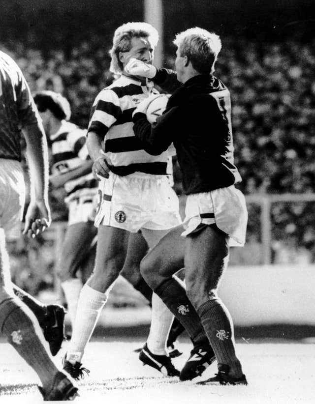 Rangers goalkeeper Chris Woods, right, tangles with Celtic's Frank McAvennie in the seventh minute of their controversial match at Ibrox Stadium
