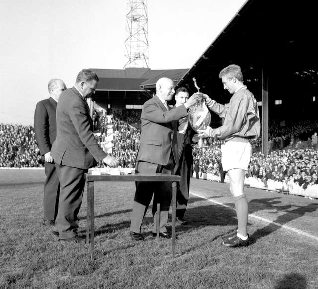 Denis Law, right, receives the Football League trophy in 1965