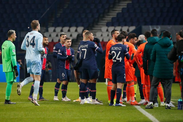 PSG players follow Basaksehir's players off the field during their Champions League tie in Paris