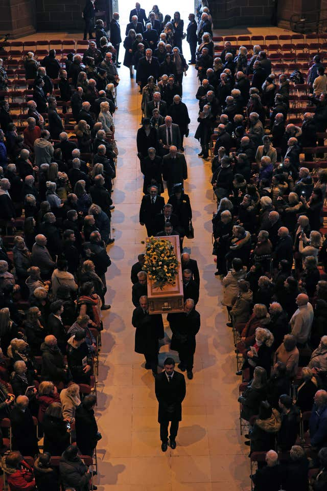 The coffin is carried in during the funeral service (Aaron Chown/PA)