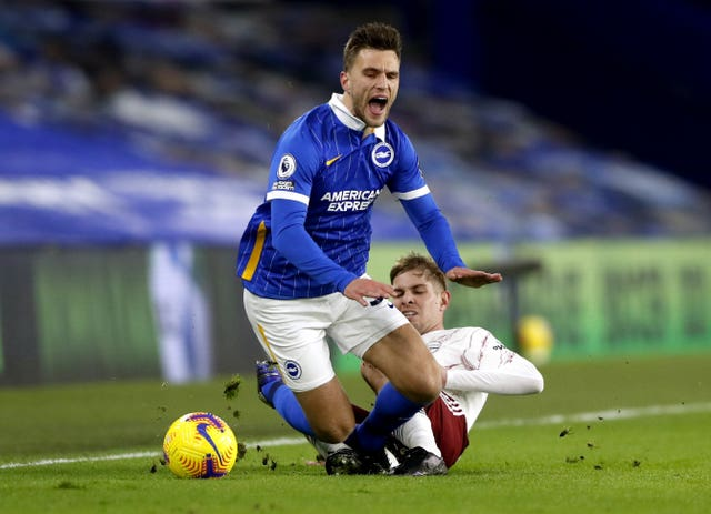 Arsenal's Emile Smith Rowe, right, tackles Brighton's Joel Veltman
