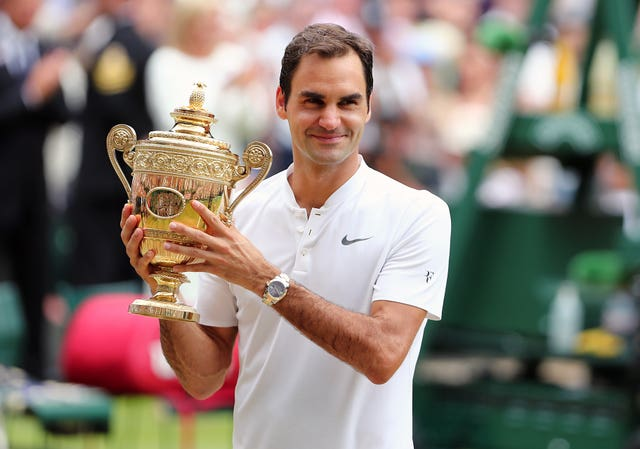 Roger Federer with Wimbledon 2017 trophy