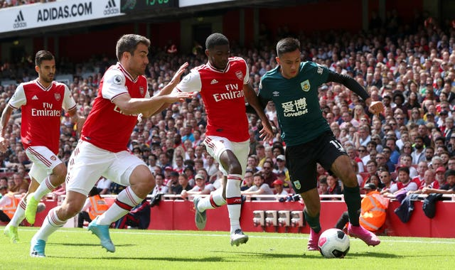 Arsenal and Burnley players battle for possession