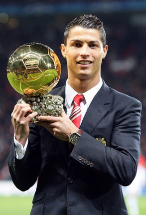 Cristiano Ronaldo poses with one of his five Ballons d'Or