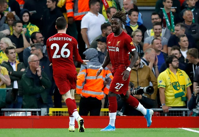 Divock Origi, right, celebrates with team-mate Andy Robertson