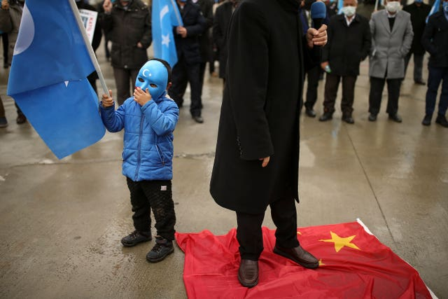 Protesters from the Uyghur community living in Turkey step on a Chineses flag Emrah Gurel/AP)
