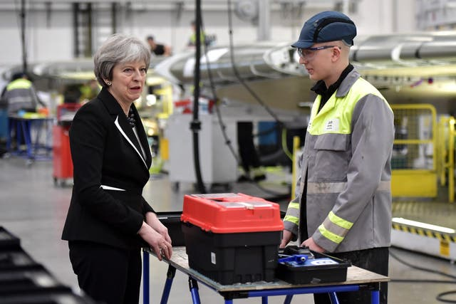 Theresa May during a visit to the Bombardier factory in Belfast (Charles McQuillan/PA)