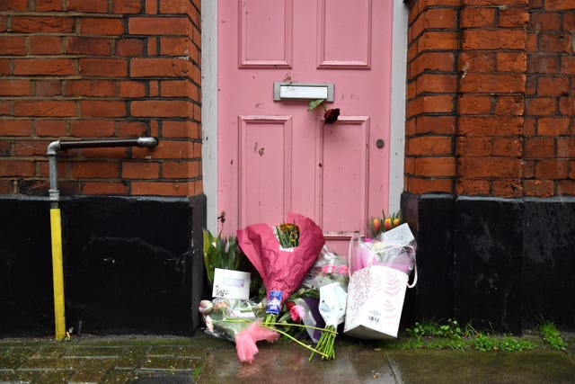Floral tributes placed outside Caroline Flack's former home