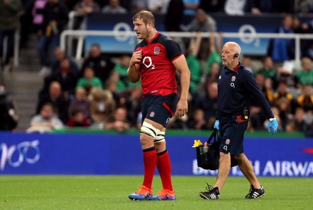 Joe Launchbury leaves the field injured at St James' Park