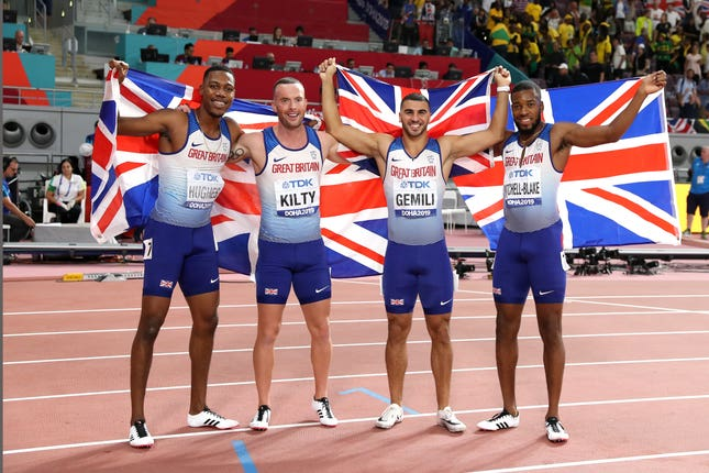 Zharnel Hughes, Richard Kilty, Adam Gemili, and Nethaneel Mitchell-Blake celebrate their medal