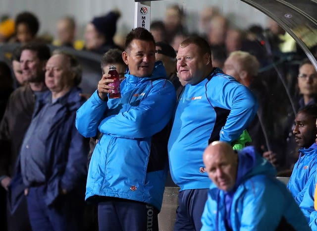 Sutton reserve goalkeeper Wayne Shaw (right) left his role at the club in the wake of the incident.